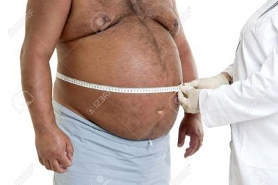 11534650-Large-male-patient-belly-with-doctor-Stock-Photo.jpg