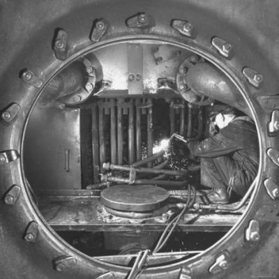 thomas-d-mcavoy-welder-with-an-acetylene-torch-cutting-through-some-of-the-old-tubes-in-a-modern.jpg